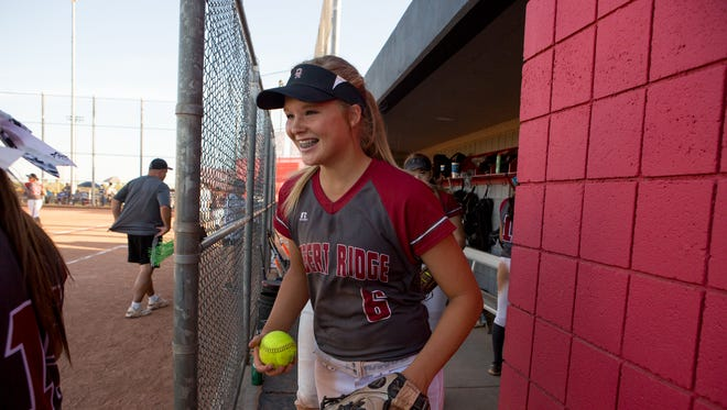 Desert Ridge High School freshman pitcher Shaylee Ackerman (center) heads to the outfield at a home game against Xavier College Preparatory on Wednesday, April 20, 2016, in Mesa Ariz.