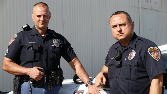 El Paso Independent School District Police Officers Javier Alvarez and Steve Romero wear two of the 50 body cameras that were issued to EPISD police officers, in January 2016 after the district purchased the cameras. The cameras record video internally and at the end of an officers shift the video is downloaded to server at police headquarters were it is stored.