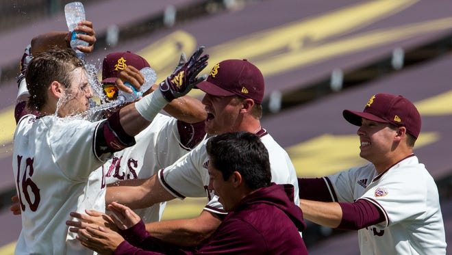 Andrew Shaps from Arizona State University (left) celebrates with his team after hitting a walk-off single against the University of New Mexico at Phoenix Municipal Stadium, on Sunday, May 1, 2016, in Phoenix, Ariz.
