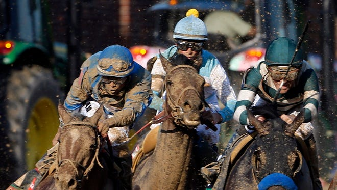 Luis Saez aboard Brody's Cause (left) races in the pack during the 142nd running of the Kentucky Derby at Churchill Downs. The Iowa-owned horse finished seventh in the race, which was won by Nyquist.
