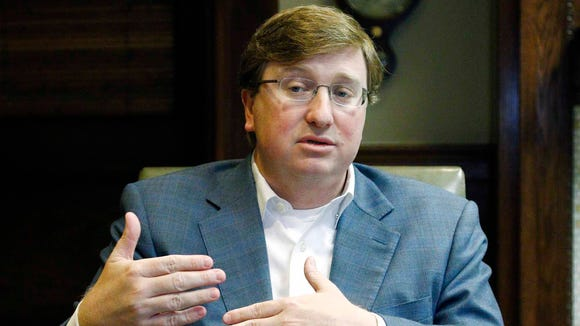 Republican Lt. Gov. Tate Reeves speaks with reporters.
