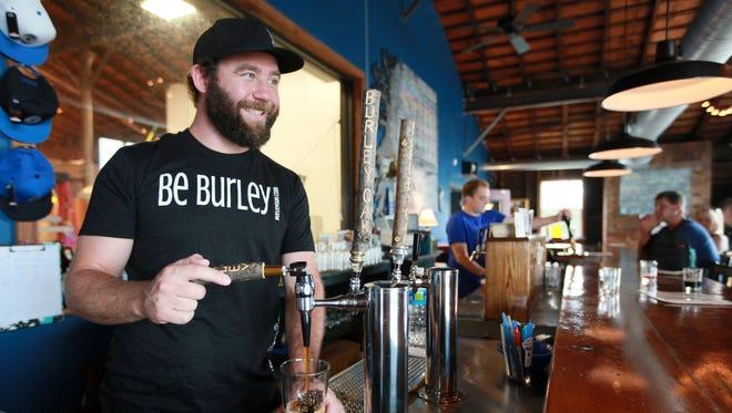 Burley Oak Brewery owner, Bryan Brushmiller, pours a beer in the brewery in Berlin.