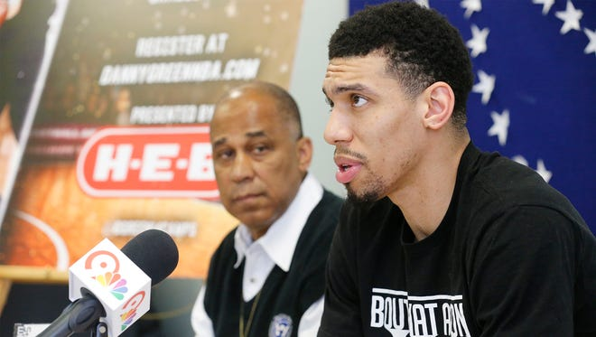 San Antonio Spurs guard Danny Green was in El Paso Wednesday afternoon to promote his up coming basketball skills camp to be held at the Don Haskins Recreation Center, 7400 High Ridge in El Paso's west side. The camp will be held July 16 and 17 for students in grades 2-12. Wayne Thornton Public Relations at El Paso Parks and Recreation Department looks on.