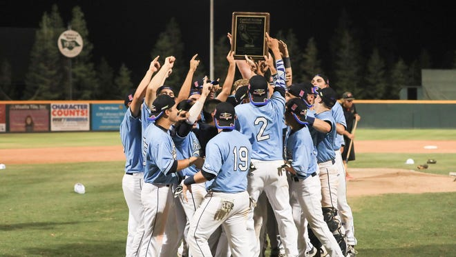 The Redwood Rangers celebrate their 14-4 win over Tehachapi in the Central Section Division II championship game.