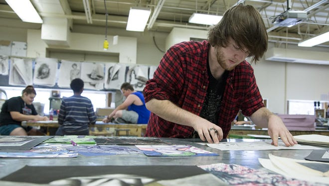Chris Jones, a senior at Great Falls High School, draws during school on May 26. Chris is an AP Art student who uses many different materials and media for his art, including newsprint.