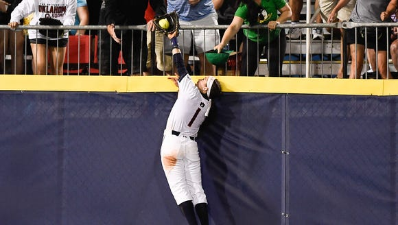 Auburn's Tiffany Howard robs a home run with a great