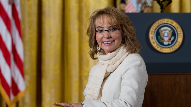 Former Arizona Rep. Gabrielle Giffords arrives in the East Room of the White House in Washington on Tuesday, Jan. 5, 2016, prior to President Obama's announcement of a more sweeping definition of gun dealers that the administration hopes will expand the number of gun sales subject to background checks. On Thursday, June 16, 2016, Giffords tweeted she was sickened about the death that day of British lawmaker Jo Cox.