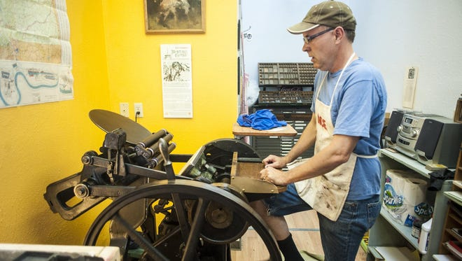 Aaron Parrett runs his 1929 letterpress with a foot pedal at the Territorial Press in Helena.