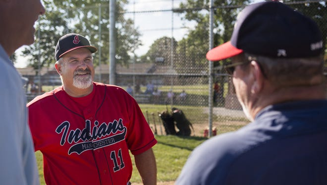 Manchester manager Dave Miller, left, and Shiloh manager Bubba Krout, right, speak prior to the two teams' game at Sunset Park in West Manchester Township on June 30. Miller played 26 years for Manchester -- from 1977 to 2003 -- before becoming the team's manager.