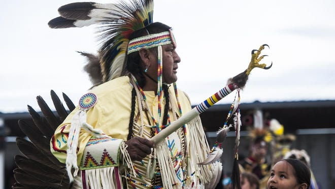 Calvin Hill, Navajo, dances in his regalia for the first grand entry during the 65th annual North American Indian Days in Browning on Thursday. The festivities will continue through Sunday evening.