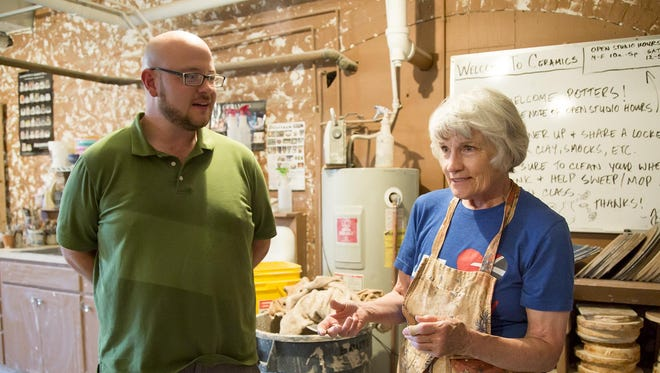 Jeff Kuratnick, left, education director at Paris Gibson Square Museum of Art, and Judy Ericksen discuss Bray Clay. A clay used in the public school system in Great Falls. Ericksen is an active member of the Great Falls creative community for more than 40 years.