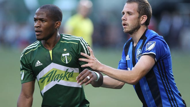 Portland Timbers' Darlington Nagbe, left, and Montreal Impact's Harry Shipp jockey for position during an MLS soccer match Wednesday, July 13, 2016, in Portland, Ore.