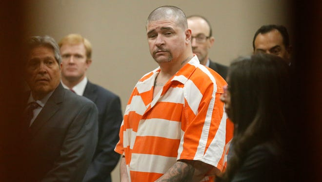 John Paul Perry, who is charged with one count of capital murder of a police officer in connection with the death of El Paso police Officer David Ortiz, stands before 243rd District Court Judge Luis Aguilar (not shown) Thursday morning. Perry is surrounded by the attorneys assigned to the case.