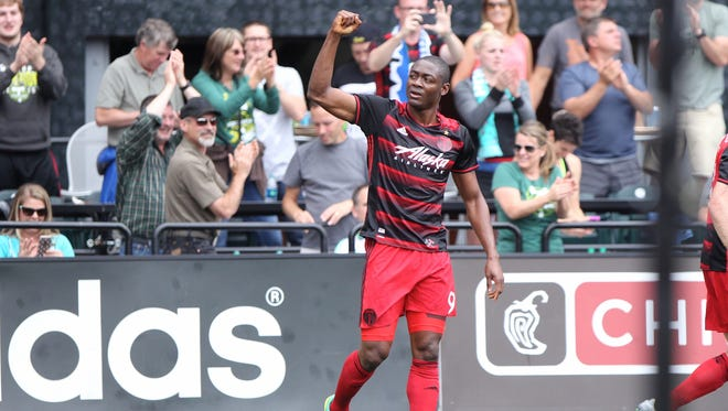 Portland Timbers' Fanendo Adi (9) salutes the crowd after his goal during an MLS soccer game against the Seattle Sounders, Sunday, July 17, 2016, in Portland, Ore. (Pete Christopher/The Oregonian via AP)