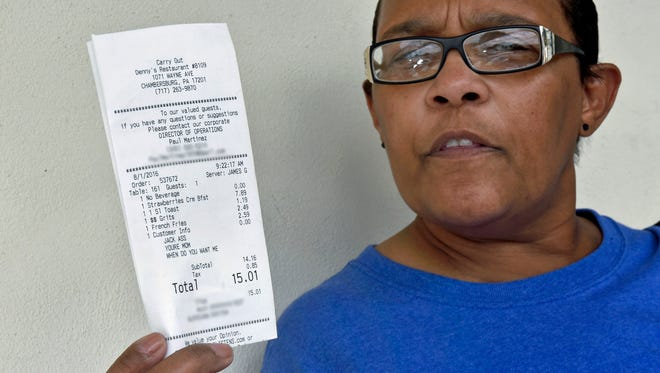 A customer at Denny's Restaurant got a surprise when she noticed questionable comments that were printed on a receipt. Pam Stoner, pictured Wednesday, August 3, 2016, noticed the writing after she picked up her order.