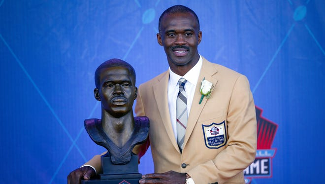 Former Indianapolis Colts wide receiver Marvin Harrison poses with his bust during the NFL Hall of Fame Enshrinement Ceremony at Tom Benson Hall of Fame Stadium in Canton, Ohio, on Aug. 6, 2016.