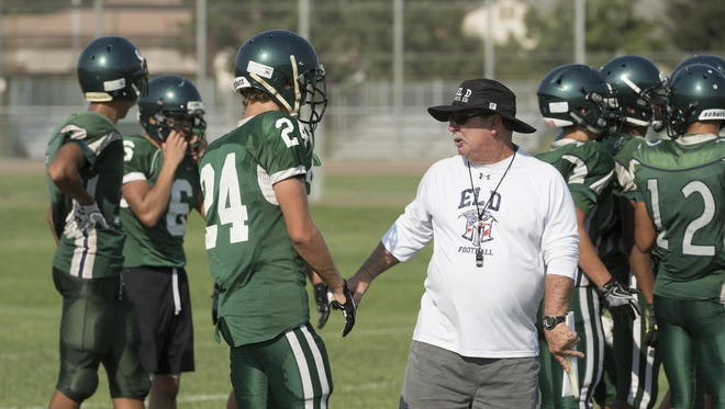 El Diamante football coach Mark Rogers talks with Mason Garispe during practice on Tuesday. Rogers is entering his 13th season as coach of the Miners.