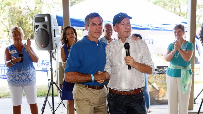 Gov. Jack Markell, right, appears with Congressman John Carney, who is running for governor as Sussex County Democrats turn out on a warm Sunday for the Annual Jamboree held at Cape Henlopen State Park near Lewes to hear statewide and local candidates speak about the upcoming November election.