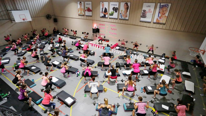 Participants pack the gym for Pump for Pink Saturday, October 1, 2016, at Club Newtone, 725 Sagamore Parkway North in Lafyaette.