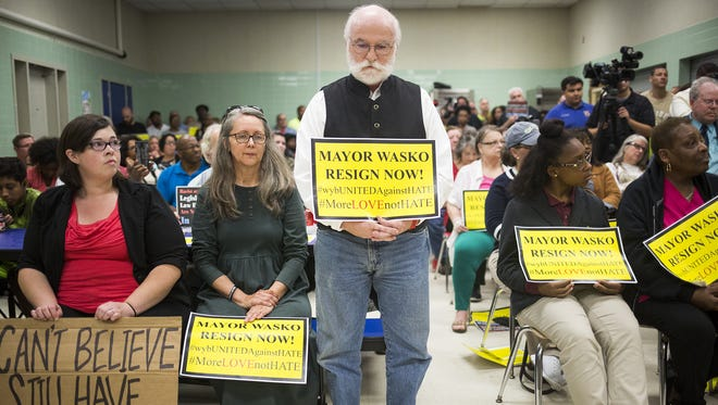 John Terlazzo, 61, of York, center, waits for his turn to speak during a recent West York council meeting. Borough Mayor Charles Wasko sent a letter this week to council members detailing four requests, saying he'd resign if at least one was met.