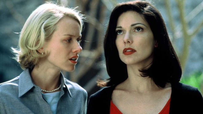 """Naomi Watts (left) and Laura Elena Harring seen in a still from """"Mulholland Drive,"""" directed by David Lynch."""