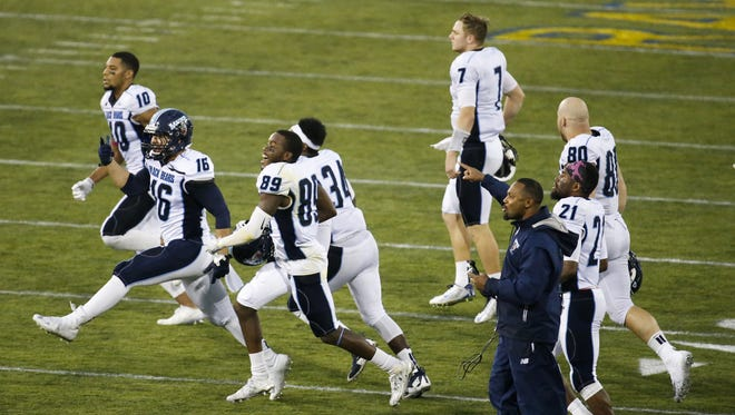 Maine celebrates after holding on to beat Delaware 28-21 at Delaware Stadium Saturday.