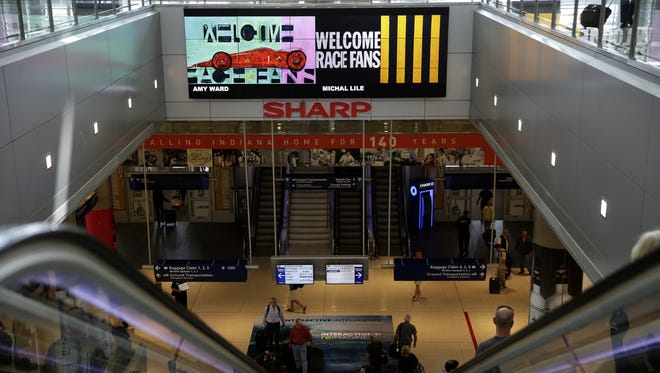 Indy 500 commercial ads and art welcomes race fans inside the Indianapolis International Airport on May 24, 2016.