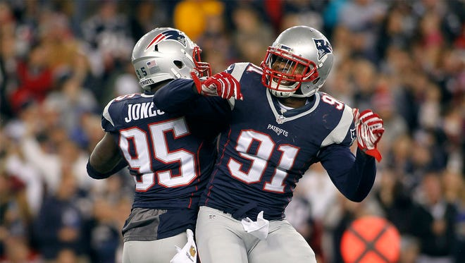 Oct 29, 2015; Foxborough, MA, USA; New England Patriots linebacker Jamie Collins (91) celebrates a sack by  defensive end Chandler Jones (95) on Miami Dolphins quarterback Ryan Tannehill during the second quarter at Gillette Stadium. Mandatory Credit: Stew Milne-USA TODAY Sports