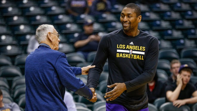 Los Angeles Lakers forward Metta World Peace (37) shakes hands with Bob Bernath, an Indiana Pacers stat crew member of 50-years, before the Lakes face the Pacers at Bankers Life Fieldhouse on Nov. 1, 2016.