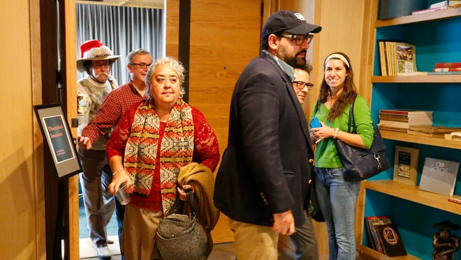 City Council members and community representatives leave a meeting on the Downtown arena Dec. 16 at the Indigo Hotel, walking past El Paso Times reporter Lindsey Anderson, right.