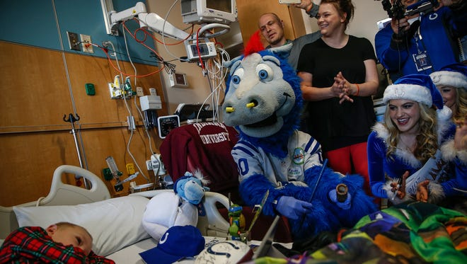 Thirteen Colts players, mascot Blue and four cheerleaders sing a holiday carol to leukemia patient Jonah Kreutzjans, 5, at Riley Hospital for Children on Monday, Dec. 19, 2016. Kreutzjans is in the hospital for a scheduled chemotherapy treatment alongside father Greg and mother Courtney.