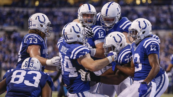 Indianapolis Colts tight end Jack Doyle (84) celebrates with teammates after catching the game-winning touchdown pass from Colts quarterback Andrew Luck (12) against the Jacksonville Jaguars at Lucas Oil Stadium on Jan. 1, 2017. The Colts won 24-20.
