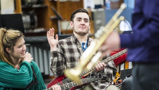 Austin Haney, a CMR senior, raises his hand during a previous jazz workshop at Great Falls High School.