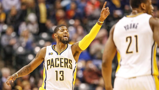 Indiana Pacers forward Paul George (13) signals to a teammate after an assist against the Brooklyn Nets in the first half at Bankers Life Fieldhouse on Thursday, Jan. 5, 2017.
