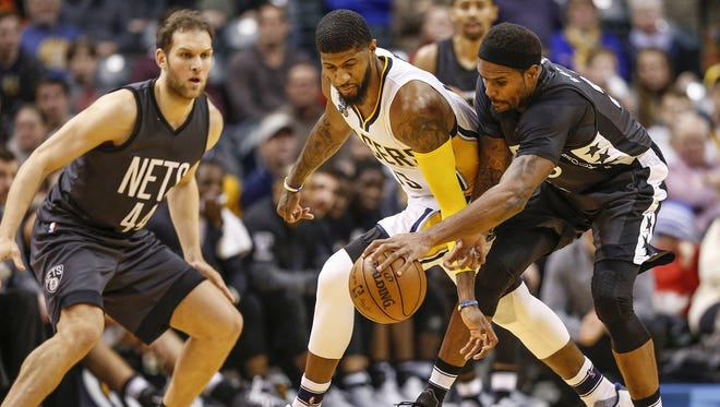 Indiana Pacers forward Paul George (13) steals the ball from Brooklyn Nets forward Trevor Booker (35) in the second half at Bankers Life Fieldhouse on Thursday, Jan. 5, 2017.