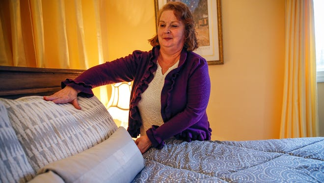 "Marsha McCormack has been renting out a room in her home on Altam Avenue in Carmel, Ind., ever since the 100th running of the Indianapolis 500. ""I just couldn't stand to watch people get scammed,"" she said. ""I charged $69 a night."" Here, she fluffs the pillows on the bed inside the room she used to be able to rent out on Airbnb on Friday, Jan. 20, 2017."