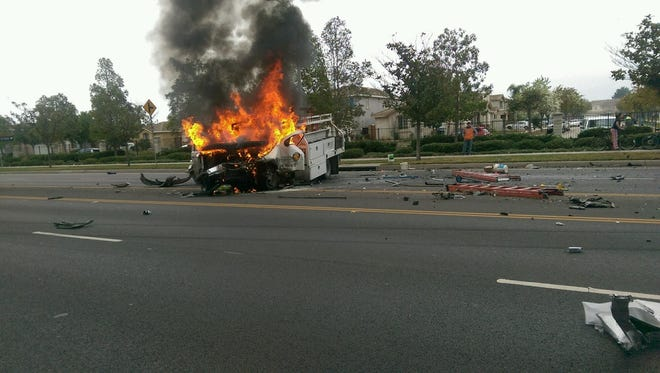 Flames engulf a truck driven by Reynaldo Lugo after a car hits it head on in Oxnard in early January.