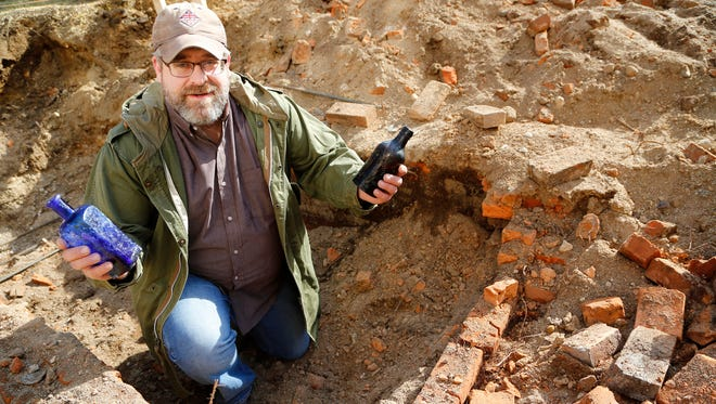Colby Bartlett at the location of an old outhouse next to the Moses Fowler House Thursday, February 2, 2017 in Lafayette. The old outhouse, which had long since been covered by soil, was discovered late Tuesday during construction work at the Moses Fowler House. Along with numerous bottles, other items including china, toys, teapot, combs, and dentures were discovered. Bartlett, who is executive director of the 1852 Foundation, said most of the items date to the 1850s to 1870s.