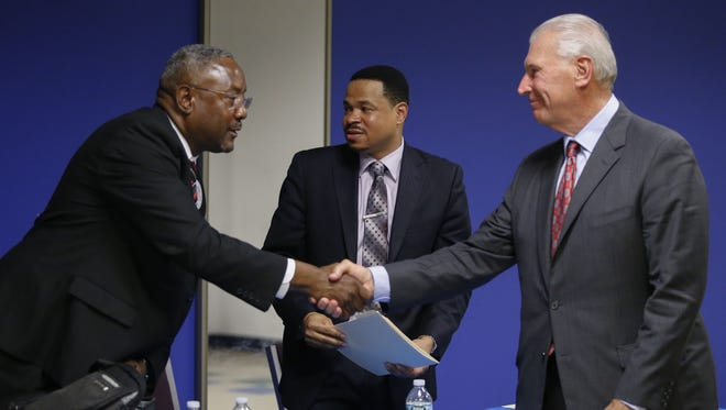Then-Wilmington mayoral candidates (from left) Independent Steven Washington, Republican Robert Martin and Democrat Mike Purzycki talk following a debate in November hosted by the Harlan Park Civic Association. Purzycki appointed Washington to the Wilmington Housing Authority board in February.