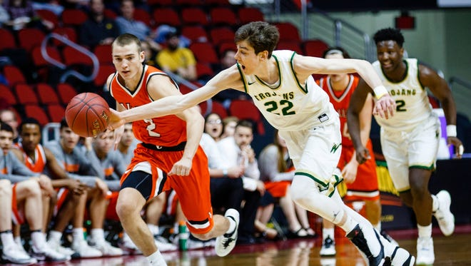 Iowa City West's Patrick McCaffery (22) steals the ball from Valley's Austin Hinkle (2) during their 4A state basketball championship game on Saturday, March 11, 2017, in Des Moines. Iowa City West would go on to win 64-50