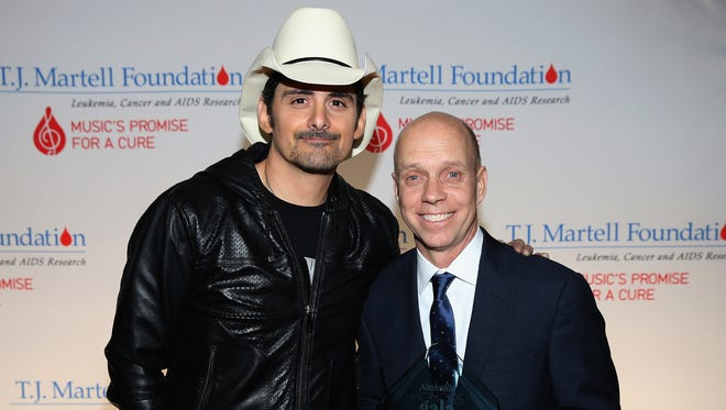 Brad Paisley and Lifetime Humanitarian Award recipient Scott Hamilton attend the T.J. Martell Foundation's ninth annual Nashville Honors Gala in 2017.