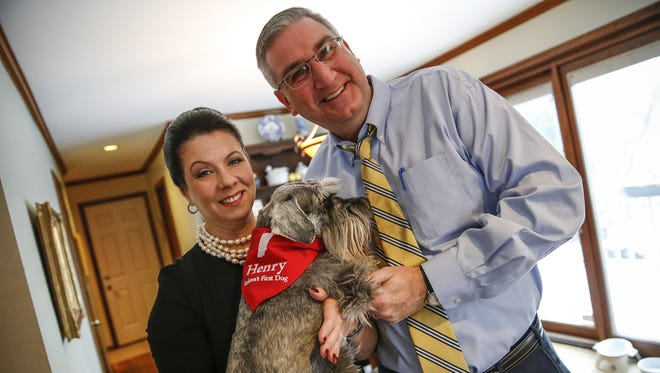 Indiana Gov. Eric Holcomb and wife Janet pose for a photo with their dog Henry, a miniature schnauzer, before Holcomb's inauguration on Jan. 9, 2017.