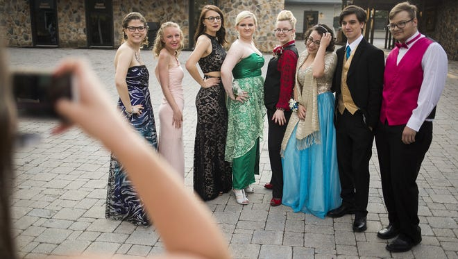 Students attend the Northeastern High School prom at Roundtop Mountain Resort in Warrington Township, April 21, 2017.