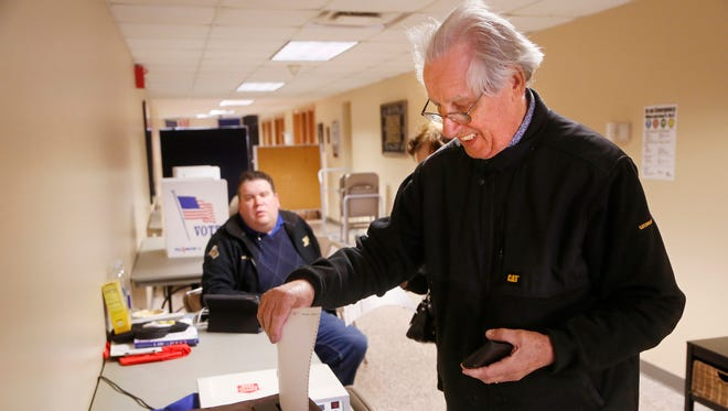 Rudy Klim casts his ballot on the West Lafayette Schools referendum Tuesday, May 2, 2017, at Cumberland Elementary School in West Lafayette.
