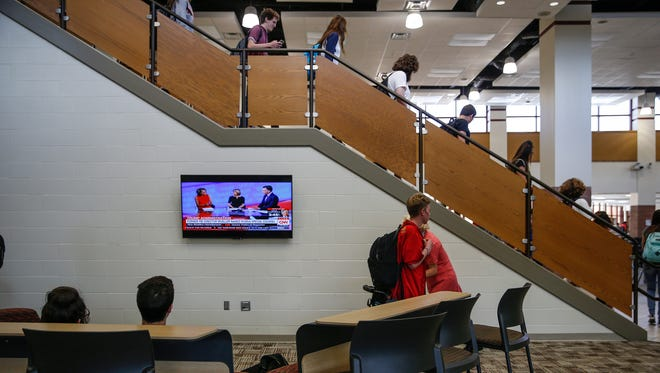 Fishers High School students gather in open-concept, common areas between classes on Thursday, May 18, 2017.