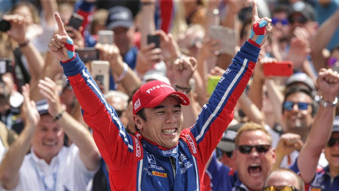 Andretti Autosport IndyCar driver Takuma Sato (26) cheers in victory circle after winning the 101st running of the Indy 500 at Indianapolis Motor Speedway on Sunday, May 28, 2017.