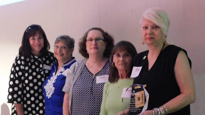Representative of the Children's Advocacy Center accept Nonprofit of the Year honors Thursday.