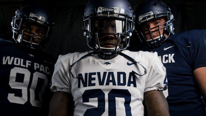 James Butler, center, Malik Reed, left, and Austin Corbett, right, lead the Wolf Pack football team in 2017.