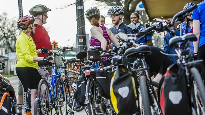 Those who attend the Lansing Bike Party ride usually gather at Lansing Bike Co-op on Fridays at 6:30 p.m.