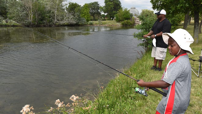 George Thomas, Jr., fishes with his father George Thomas during a July 28 trip to Belle Isle. The duo were fishing one of the island's many interior lakes and were findhing some success with worms that day.